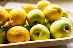 Golden apples and lemons Stock Image