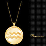 Golden Aquarius Medallion. Golden Pendant Necklace with star burst design and gold chain, with the embossed Horoscope symbol for the astrology Air Sign, Aquarius Royalty Free Stock Photos