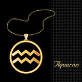 Golden Aquarius Pendant. Golden embossed horoscope symbol, necklace and gold chain, for the astrological Air Sign, Aquarius, with a textured black background Royalty Free Stock Photo