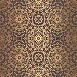 Golden Arabesque Pattern. Vector arabesque pattern. Seamless flourish mandala background with golden floral elements. Intricate ornate lines. Arabic decorative Royalty Free Stock Photos
