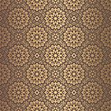 Golden Arabesque Pattern. Vector arabesque pattern. Seamless flourish mandala background with golden floral elements. Intricate ornate lines. Arabic decorative Stock Images