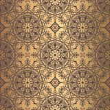 Golden Arabesque Pattern. Vector arabesque pattern. Seamless flourish background with golden floral elements. Intricate ornate lines. Arabic decorative design Royalty Free Stock Images