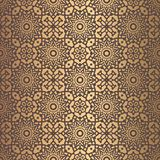 Golden Arabesque Pattern. Vector arabesque pattern. Seamless flourish mandala background with golden floral elements. Intricate ornate lines. Arabic decorative Stock Photography