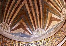 golden Arabic calligraphy on ceiling of a mosque Royalty Free Stock Images