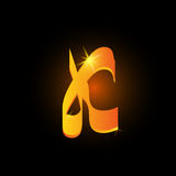 Golden arabic style letter k. Shiny latin alphabet element icon on black background. Oriental calligraphy design. Fiery Stock Photos
