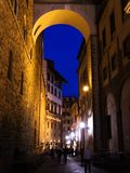 Golden Arch. A beautiful arch walkthrough at night in Florence Italy Royalty Free Stock Photography