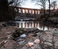 Golden arches. Frosty early morning sunlight on Cefn Coed viaduct royalty free stock image