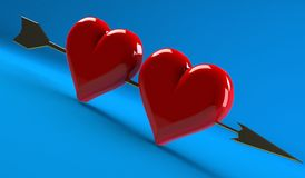 Golden arrow of Cupid pierces the heart Stock Images
