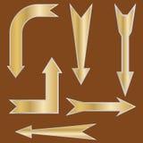 Golden arrow-pointers Royalty Free Stock Photos