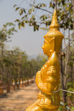 Golden asian angel statue beside the walkway Royalty Free Stock Images