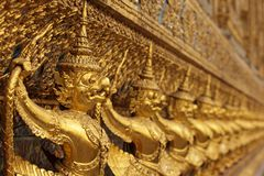 Golden asian statues Stock Image