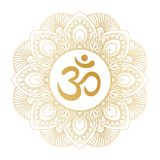 Golden Aum Om Ohm symbol in decorative round mandala ornament. Stock Photo