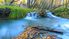 Golden Autumn in Arrowtown and waterfall Royalty Free Stock Photography