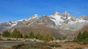 Golden autumn day in Zermatt. Gabelhorn and Dent Blanche in autumn. Zermatt stock photo
