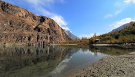 Golden Autumn Reflection Of Khalti Lake, Gupis, Ghizer District, Pakistan. Golden Autumn Reflection Landscape Of Khalti Lake In the Tehsil Gupis of Ghizer Royalty Free Stock Photo