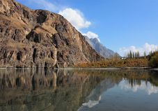 Golden Autumn Reflection Of Khalti Lake, Gupis, Ghizer District, Pakistan. Golden Autumn Reflection Landscape Of Khalti Lake In the Tehsil Gupis of Ghizer Royalty Free Stock Photography