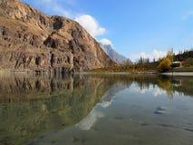 Golden Autumn Reflection Of Khalti Lake, Gupis, Ghizer District, Pakistan. Golden Autumn Reflection Landscape Of Khalti Lake In the Tehsil Gupis of Ghizer Stock Photo