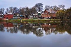 Golden autumn,small cottage near river Stock Photo