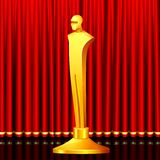 Golden Award. Illustration of gold award in shape of male statue on stage curtain backdrop Royalty Free Stock Photo