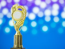Golden award winning trophy with abstract bokeh. And Blurry or defocus of light spot background Royalty Free Stock Photos