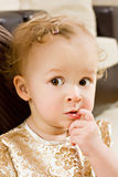 Golden baby. Little girl in your room Stock Images