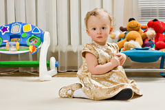Golden baby. Little girl in your room Royalty Free Stock Photography