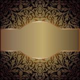 Golden background. Dark background with floral ornaments and copy space Stock Images