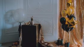 Golden background. Black and gold balloons. Decoration for birthday, anniversary. Festive interior stock video footage