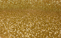 Golden background of blurred glitter Royalty Free Stock Image