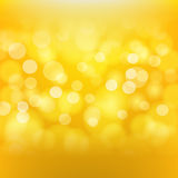 Golden background with blurred light effects Stock Photos
