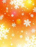Golden background with bokeh and blurred snowflakes, vector Stock Photos