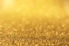 Golden background bokeh Stock Photography