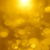 Golden background. Bright golden background with some blurred lights in it Royalty Free Stock Image