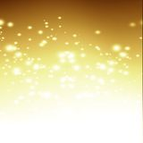 Golden background. Bright golden background with some blurred lights in it Stock Image