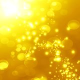 Golden background. Bright golden background with some blurred lights in it Stock Photo