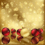 Golden background with Christmas baubles Royalty Free Stock Images