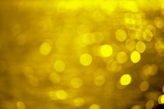 Golden background created from picture of golden bokeh water. stock photo