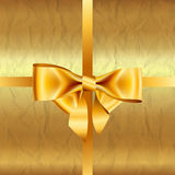 Golden background with crumpled paper and bow Royalty Free Stock Photography