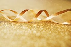 Golden background with festive loop Stock Photos