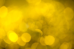 Golden background. Golden festive New Year's background. Abstract with bright twinkles, sparkles, blurred, defocused light Stock Images