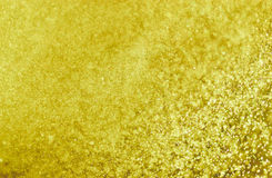 Golden Background formed by water droplets, a beautiful pattern. Stock Photos