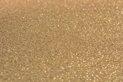 Golden glittering background as a template stock images