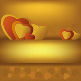 Golden background with hearts Royalty Free Stock Images