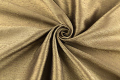 Golden background luxury cloth or wavy folds of grunge silk texture satin Stock Photos