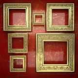 Golden background painted in red Stock Photo