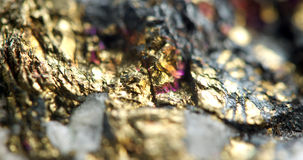 Golden background, rather unique macro photo a rare nugget, for. Golden background rather unique macro photo a rare nugget, for your bright golden successful Stock Images