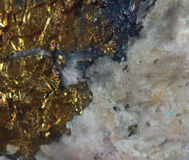 Golden background, rather unique macro photo a rare nugget. For your bright golden successful business design Stock Photos
