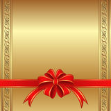Golden background. With a red bow for gifts Royalty Free Stock Photo