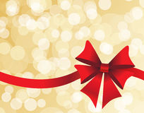 Golden background with a red bow Royalty Free Stock Image