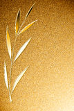 Golden background with shiny palm branch Stock Images